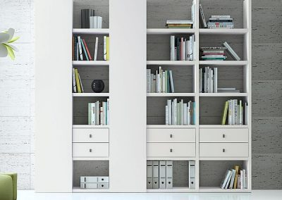 witte boekenkast met deuren en laden